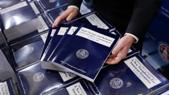 In this May 23, 2017, file photo, copies of President Trump's fiscal 2018 federal budget are seen on Capitol Hill.