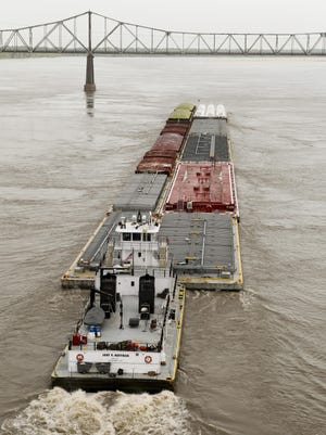 This file photo shows barge traffic on the Mississippi River at Greenville.