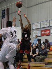 NFC's Victor Clark fires a 3-pointer during a District