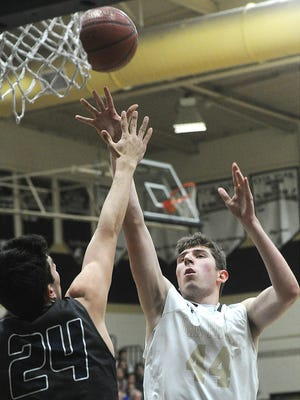 Oak Park's Riley Battin scores over Camarillo's Jamie Jaquez Jr. during a game earlier this season. The two superstars can be forces inside but also have become adept 3-point shooters.