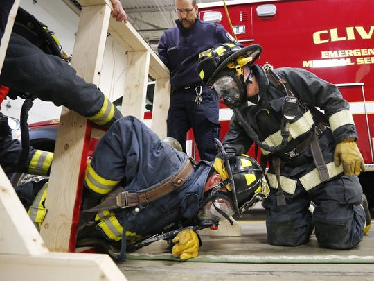 Clive firefighters climb through an obstacle during training at the firehouse in 2015.