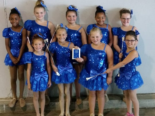 Americettes Juvenile Blue Team. From left, front, are