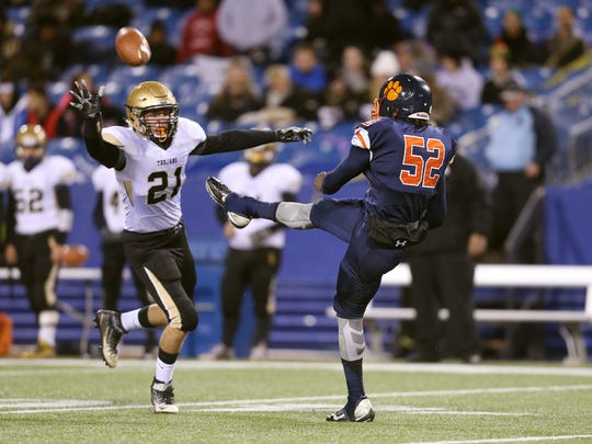 Kyle Benham (21), shown here trying to block a punt against Buffalo Bennett, and the Athena defense face a Somers back with more than 2,000 rushing yards during the Class A final.