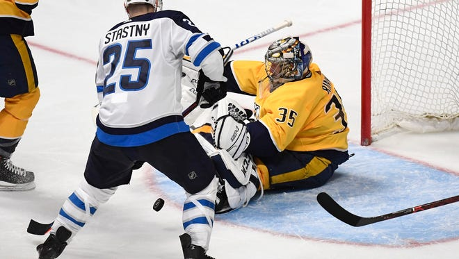 Jets center Paul Stastny (25) shoots his goal on Predators goalie Pekka Rinne (35) during the second period in game 1 of the second round NHL Stanley Cup Playoffs at the Bridgestone Arena Friday, April 27, 2018, in Nashville, Tenn.