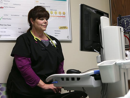 Penny Stewart works her shift as a nurse in the intensive-care unit at San Angelo Community Medical Center on May 7.