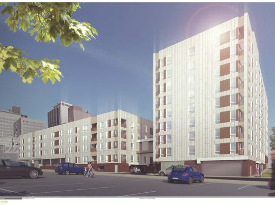 A rendering of the Residences at Mid-Town Park, a two-building, 200-unit apartment complex with a 500-space, underground parking garage, is shown. The project is under construction at Ninth and Orange streets in Wilmington.