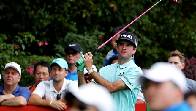 Bubba Watson watches his shot at the Shenzhen International golf tournament in Shenzhen, in China's southern Guangdong province on April 20.