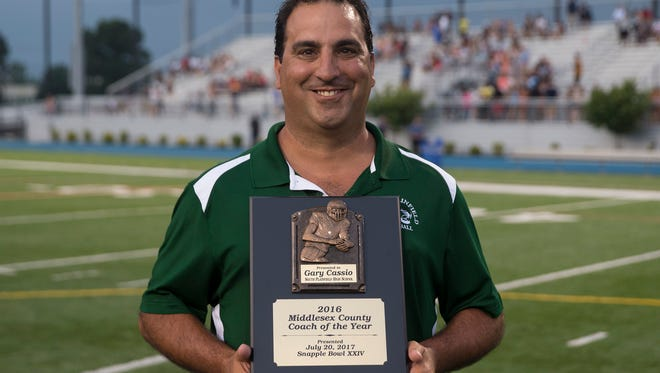 South Plainfield Coach Gary Cassio with his Middlesex County Coach of the Year award. Middlesex County vs Union County in the Snapple Bowl XXIV at Kean University in Union, NJ on July 20, 2017.