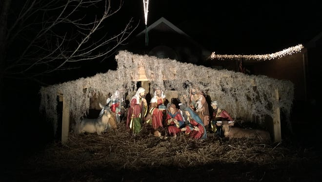 A nativity scene in the Cambridge Farms subdivision was put back on display Monday after a figurine was stolen last week.
