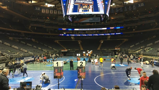Wrestlers practice Wednesday afternoon inside Madison Square Garden, site of this week's NCAA Championships.