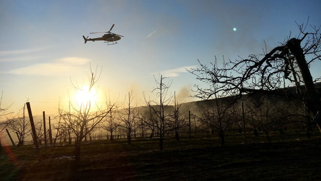 Fishkill Farms in Hopewell Junction rented a helicopter through Wings Air Helicopter to raise temperatures near the farm's fruit trees.