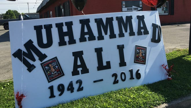 Whit's Liquor owner Angie Whitfield made this sign. Muhammad Ali's father painted her store's old sign (no longer here).