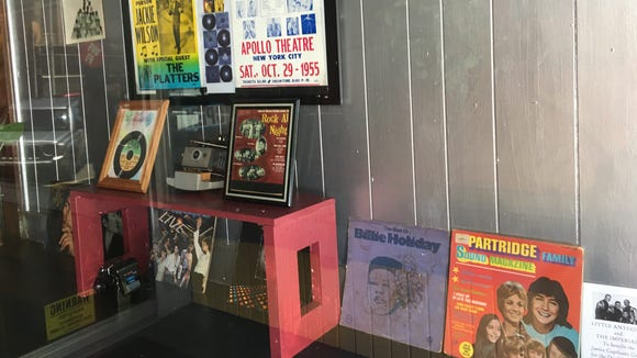 The window display outside A Touch of Soul Cafe in downtown Montgomery features old album covers, posters and other items.