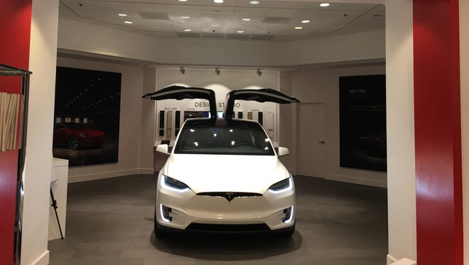 The small gallery features a Model X SUV and consumers can learn more about electric vehicles from Tesla employees.