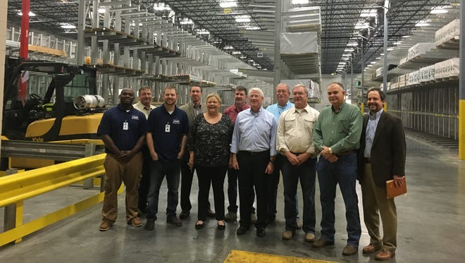 Sen. Roger Wicker, center, toured Lowe's distribution center in Purvis with a group of Lamar County officials.