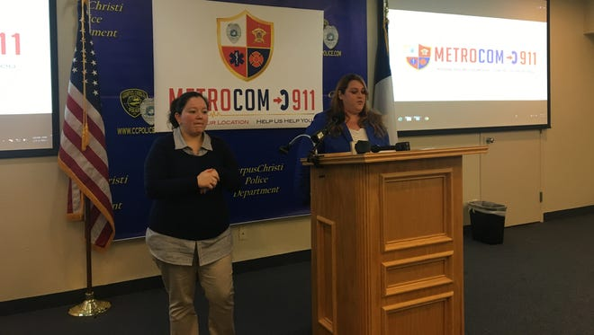 Angelica Tijerina (left), an interpreter with the Deaf & Hard of Hearing Center, helps during Kathleen Porche's presentation on MetroCom's new Text-to-911 system.