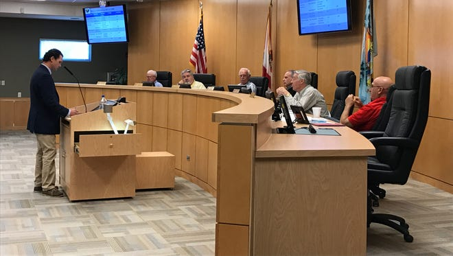"""Richard Cannone (left) of Calvin, Giordano & Associates, Inc. presents the list of 33 """"glitches"""" within the city's Land Development Code to the Marco Island Planning Board on Friday, Dec. 2, 2016. The new planning board met Friday to continue revising the LDC."""