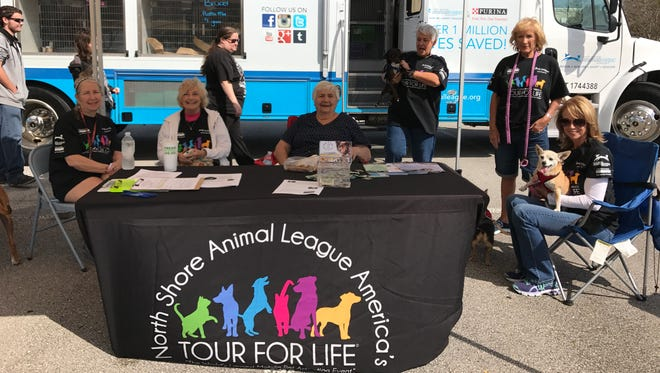 Dogs & Cats Forever volunteers at the Tour For LIfe bus