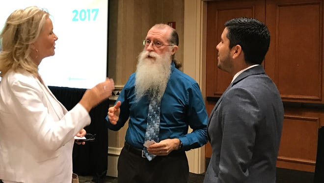 Mark Strain, Collier County's hearing examiner, talks to Greater Naples Chamber of Commerce members after his presentation at a Wake Up Naples breakfast June 14, 2017.