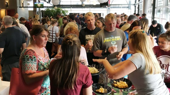 A crowd samples cheese at the 2016 Moo & Brew at the Milwaukee Public Market. The sampling of cheese, ice cream and beer returns June 22, with proceeds from the $20 admission fee going to Hunger Task Force.