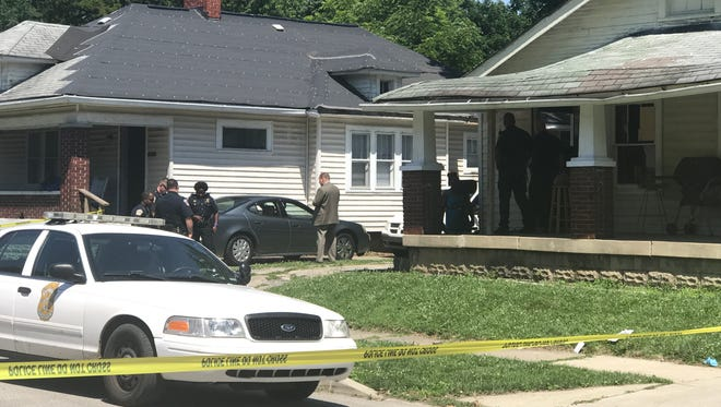 Police investigate a shooting in the 3400 block of East 26th Street that left one woman in critical condition Monday