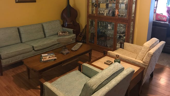 My mother's old furniture has found a new home in my living room.