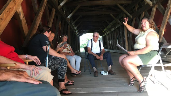 Debbie Haubert, naturalist with Sandusky County Parks District, talks about the history of Mull Covered Bridge on Thursday evening. The bridge was built in 1852 and was renovated last year. One of the last remaining covered bridges in Northwest Ohio, theMull Covered Bridgewas listed on the National Register of Historic Places in 1974.