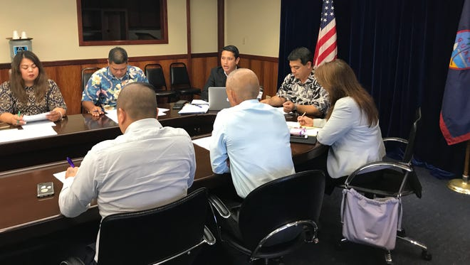 Government of Guam officials including (left to right) Department of Corrections Deputy Director Kate Baltazar, Northern Marianas Rep. Ivan Blanco, Sen. Wil Castr, former Sen. Tony Ada, Sen. Louise Muna, Guam Homeland Advisor George Charfauros and Office of Civil Defense Administrator Charles Esteves conduct a meeting at Adelup on Aug. 23, 2017 to discuss ways of improving local and regional security.