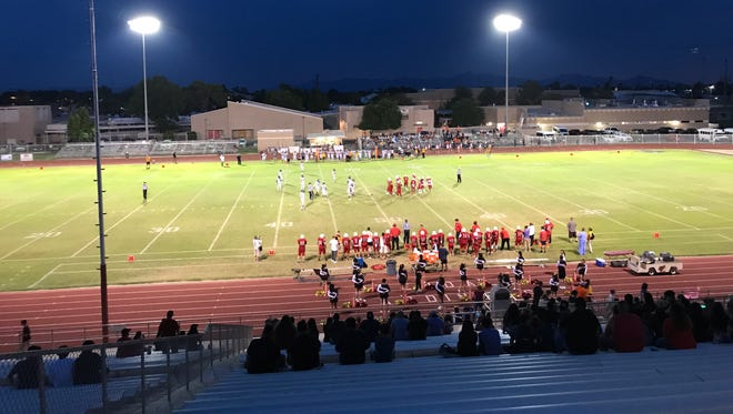 The San Tan Valley Poston Butte Broncos and Glendale Cardinals are on the field in the first quarter of their game on Friday, September 8, 2017.