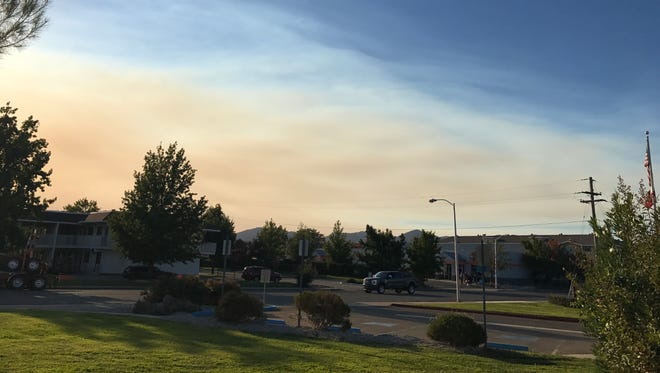 Smoke from the Buck Fire is seen billowing into north Redding from Trinity County.