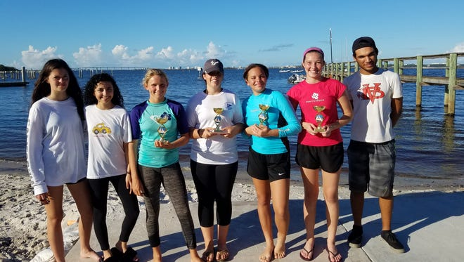 Seven Youth Sailing Foundation high school sailors competed in a recentTreasure Coast Youth Series #2 Regatta in Jensen Beach. Pictured are, from left, Maria McGuire, Lisa Moscoso, Mylee Smith, Holly Gandolfo, Nita Holloway, Sydney Ohs, and Bryan DeJesus Camacho.