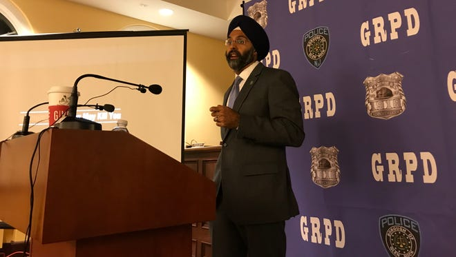 Bergen County Prosecutor Gurbir Grewal informs Glen Rock residents about new tactics his office has undertaken to stem the growing opioid epidemic.