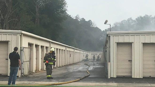 Crews work to extinguish large storage unit fire on Thursday, Jan. 11, 2018, off Tippin Avenue in Pensacola.
