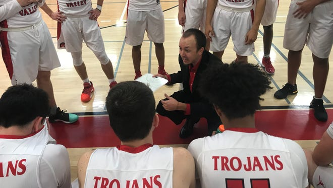 Paradise Valley head coach Cory Bardet talks to his team during a timeout against Arcadia.