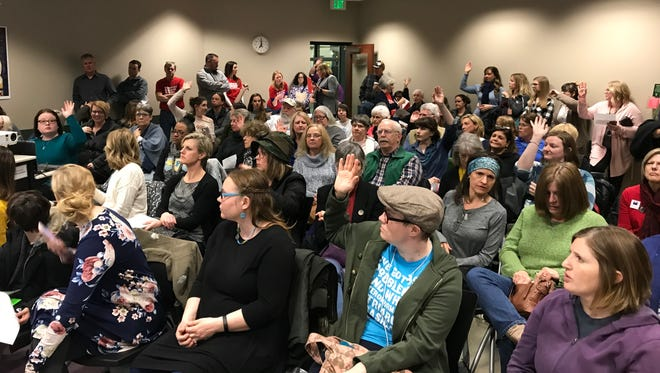 More than 110 people attended the Moms Demand Action for Gun Sense in America meeting Thursday at the Library Center. The group usually has about 15-20 people in attendance.