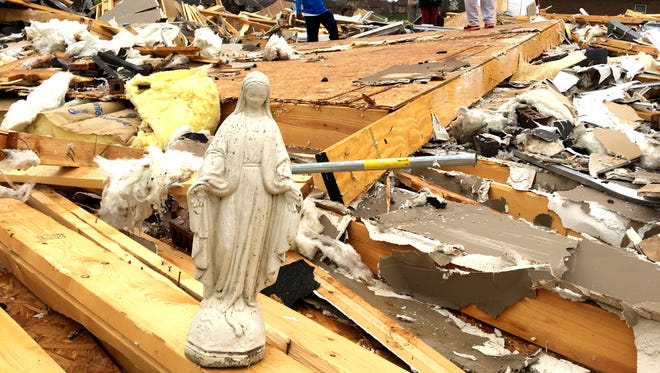 A statue of Mary was among the items volunteers salvaged from the rubble of a destroyed home in Clarksville on Sunday, Feb. 25, 2018.