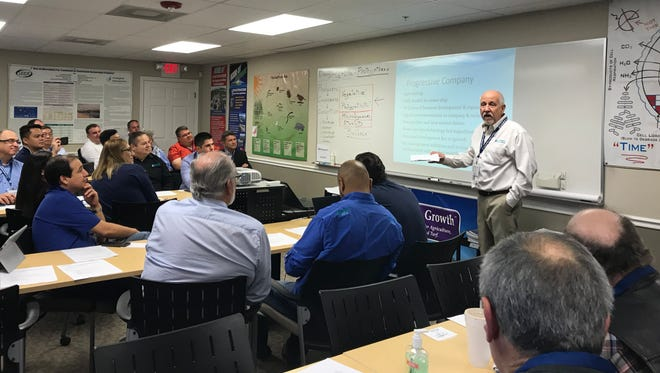 Barry Richter, president of Ecological Laboratories, gives a presentation to international customers at the company's Cape Coral offices in January.