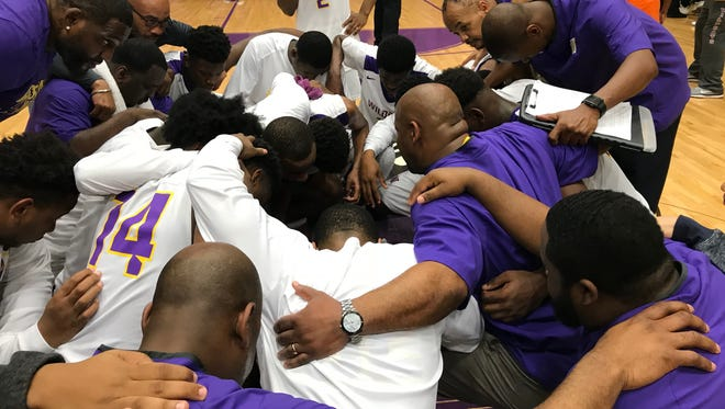 Wossman celebrates its 57-47 win over Carroll in the Class 3A semifinals with a postgame prayer.
