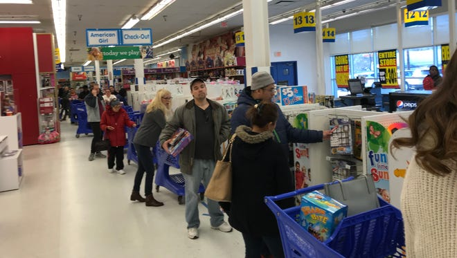 The line at the Toys R Us store on Route 17 in Paramus on the first day of the liquidation sale.