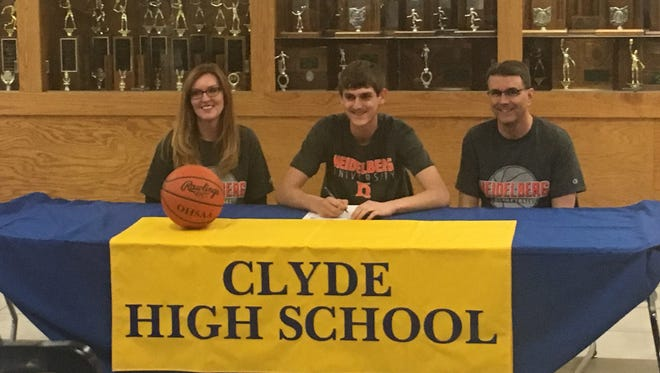 Clyde senior Seth Hohman will continue his basketball career at Heidelberg. He is joined at his announcement by mother, Jennifer, and father, Barry.