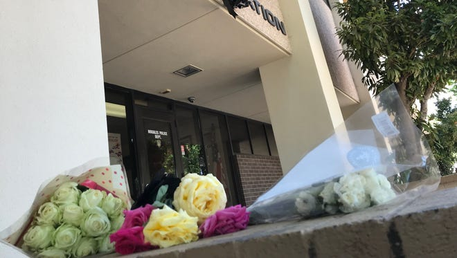 """Nogales residents began leaving flowers outside the police department on Saturday, April 28, 2018, to honor slain officer Jesus """"Chuy"""" Cordova."""