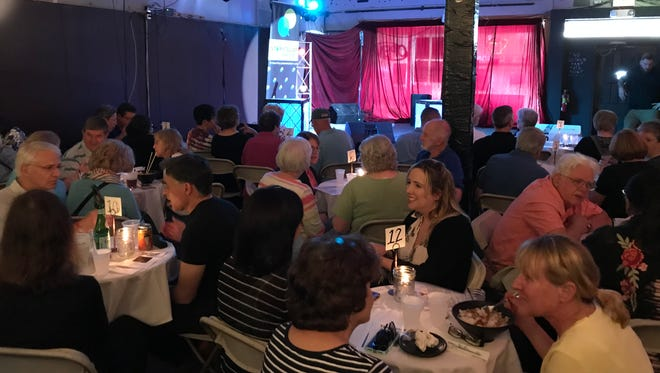 The crowd is gathered for the LSJ Storytellers Project event May 15 at the Avenue Cafe.