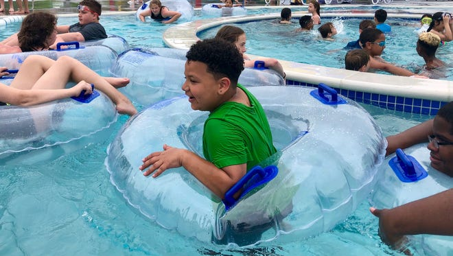 Patrons swim and play at the new Chambersburg Aquatic Center the afternoon of Monday, May 28. The new center officially opened to the public on Saturday, May 26.