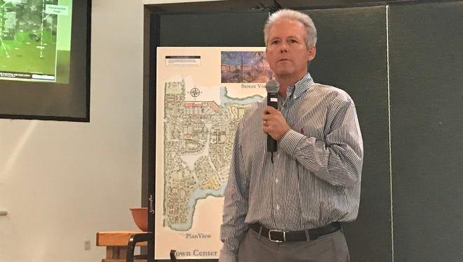 Patrick Utter, vice president of real estate for Collier Enterprises, makes a presentation on Rural Lands West at neighborhood information meeting.