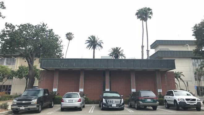 The parking spots reserved for the five members of the Oxnard City Council are seen outside the Council Chambers. In November, two more spots will be needed for new council members representing south Oxnard.