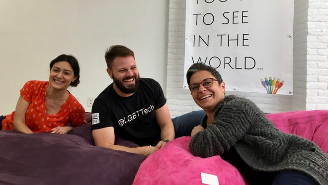 Ellie Bessette, Christopher Wood and Deborah Seif from Staunton's LGBT Tech celebrate the opening of the Shenandoah LGBTQ Center on Tuesday, July 17, 2018. One of the first initiatives of the center is to have pride festival in downtown Staunton. Set for the weekend of Oct. 5-7, Staunton Pride invites local organizations, businesses and support groups to join them in creating a community event celebration.