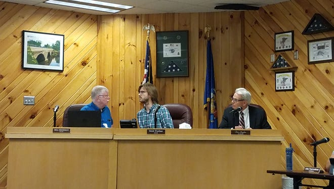 Merrill Mayor Derek Woellner, center, presides over a public meeting about the performance of city administrator Dave Johnson. Woellner called in a Facebook post for Johnson's firing.