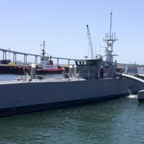 A self-driving, 132-foot military ship sits at a maritime terminal Monday in San Diego. The Pentagon's research arm is launching tests on the world's largest unmanned surface vessel designed to travel thousands of miles at sea without a crew.