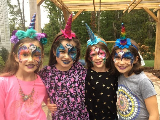 Unicorn parties are big business for Party Business of Wilmington, Delaware, and allow co-owner Dori Fostok to show off her face painting skills.