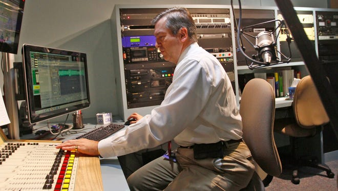 KSJE General Manager Scott Michlin is seen on April 24 during a show at the radio station in Farmington. The station is shifting to a listener-supported business model.